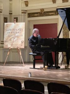 """Michael Coleman performed his original composition """"Room 857"""" at Ehrbar Hall in Vienna, Austria in August at the Golden Key of Vienna Music Festival. He won First Diploma in the 2019 International Golden Key Composition Competition."""